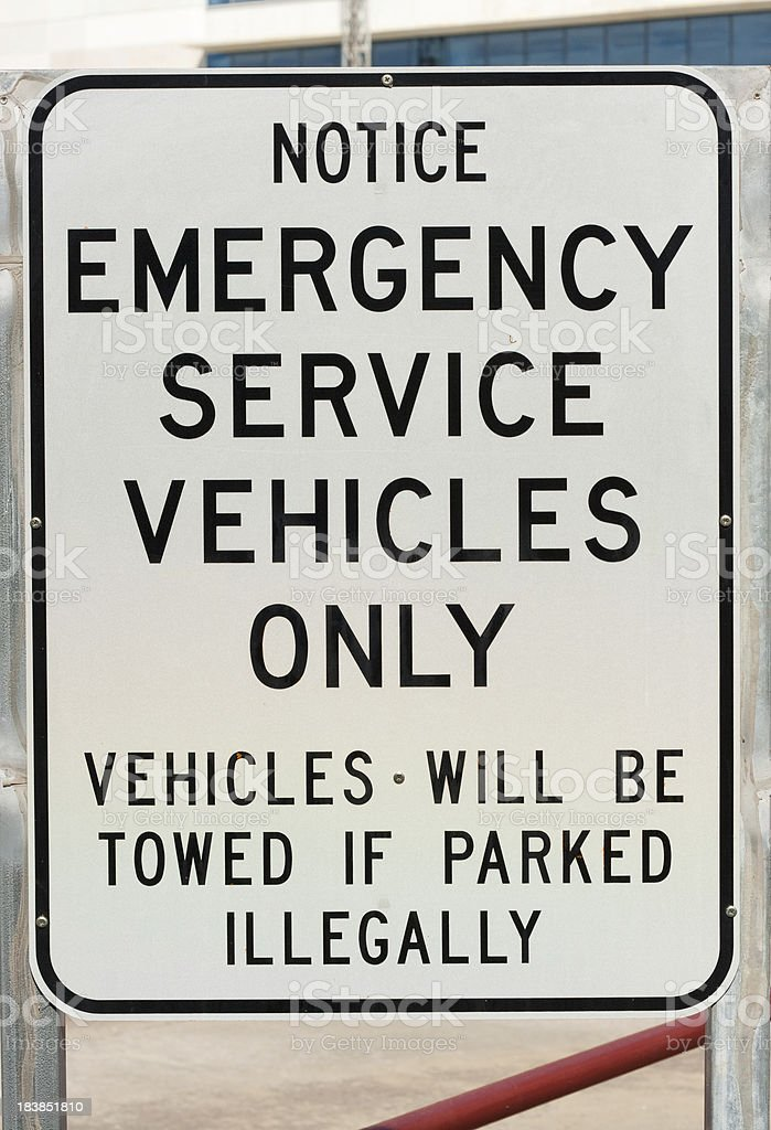 Sign advising that non emergency vehicles will be towed if parked...