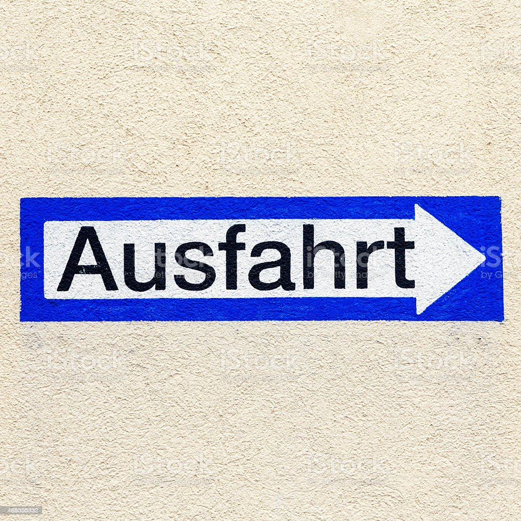 sign exit in german painted at a wall stock photo