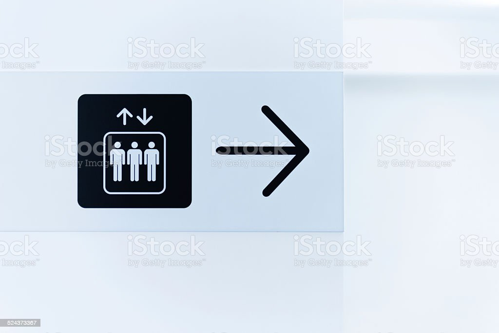 sign for a lift stock photo