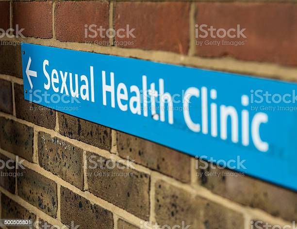 Sign For A Sexual Health Clinic On A Brick Wall Stock Photo - Download Image Now