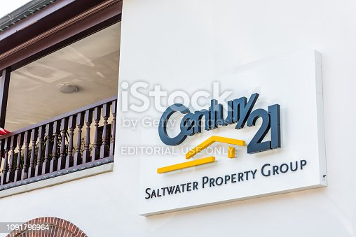 istock Sign for Century 21 Saltwater Property Real Estate group and nobody on street closeup in Florida city historic architecture 1091796964