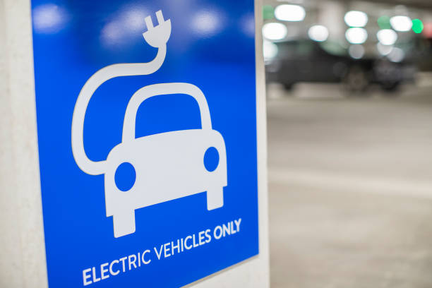Sign For Electric Car Charging Point In Car Park stock photo