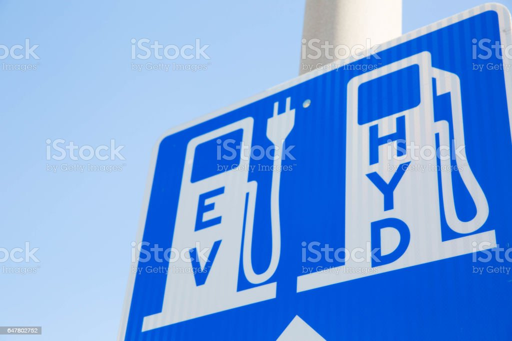 Sign for Electric Vehicle and Hydrogen Fueling Charging Station Renewable stock photo