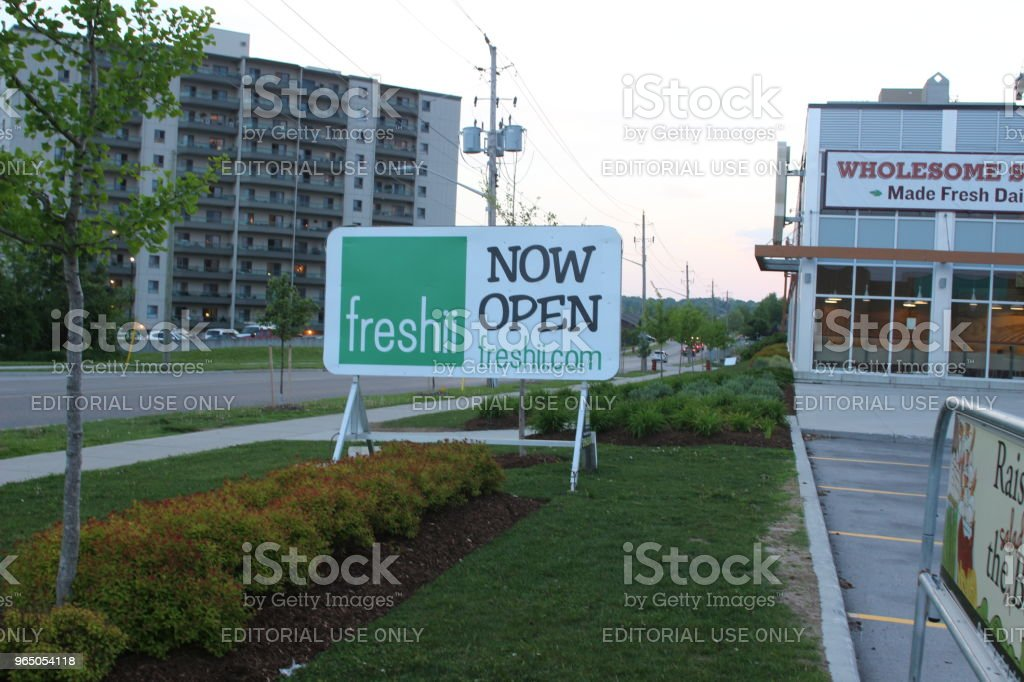 A sign for Freshii restaurant anouncing the grand opening of a new location. Freshii is a Canadian healthy fast food chain zbiór zdjęć royalty-free