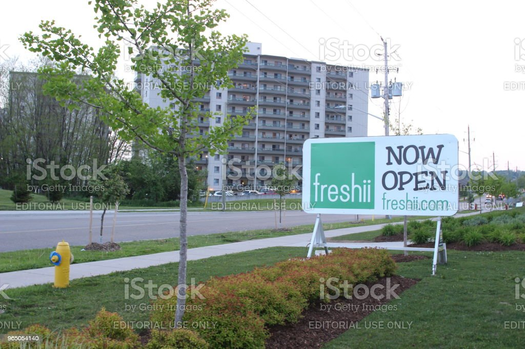 A sign for Freshii restaurant anouncing the grand opening of a new location. Freshii is a Canadian healthy fast food chain royalty-free stock photo