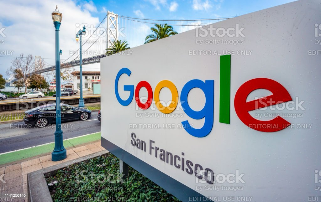 Sign for Google officies in San Francisco San Francisco, USA - A large sign outside Google's offices in San Francisco, with the San Francisco - Oakland Bay Bridge in the background. Google - Brand-name Stock Photo
