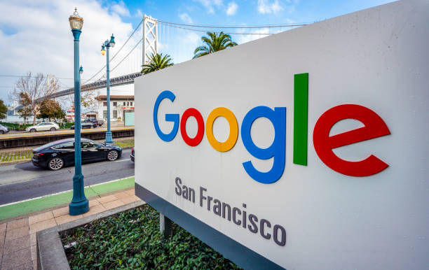 Sign for Google officies in San Francisco San Francisco, USA - A large sign outside Google's offices in San Francisco, with the San Francisco - Oakland Bay Bridge in the background. google stock pictures, royalty-free photos & images