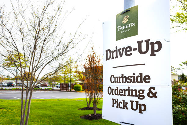 Sign for open Panera restaurant for take-out curbside pick-up during coronavirus covid-19 epidemic stock photo