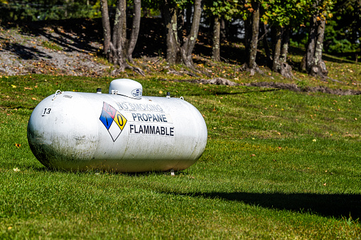 Cass, USA - October 6, 2020: Sign for Southern States propane butane energy residential storage tank with danger warning for flammable fuel in West Virginia