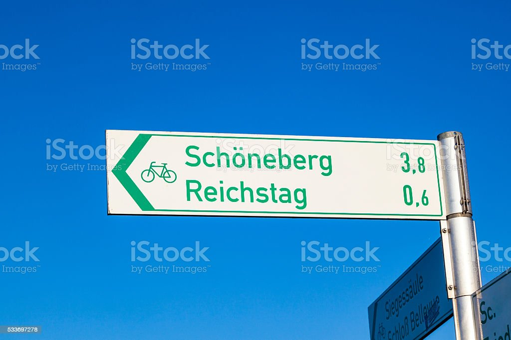 sign for tourists direction reichstag and SChoenefeld in Berlin,...