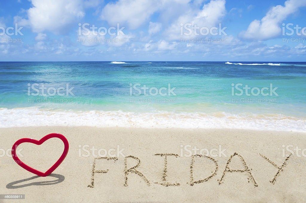 Sign 'Friday' on the sandy beach stock photo