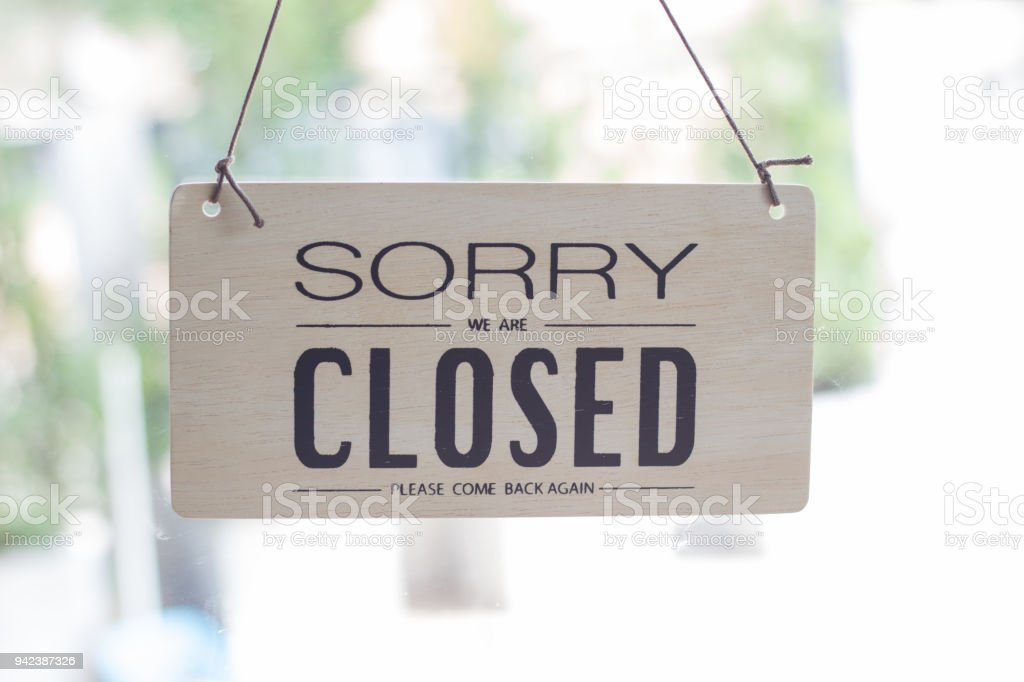 A sign hanging off Coffee shop door,Close sign blur background,Label word close stock photo