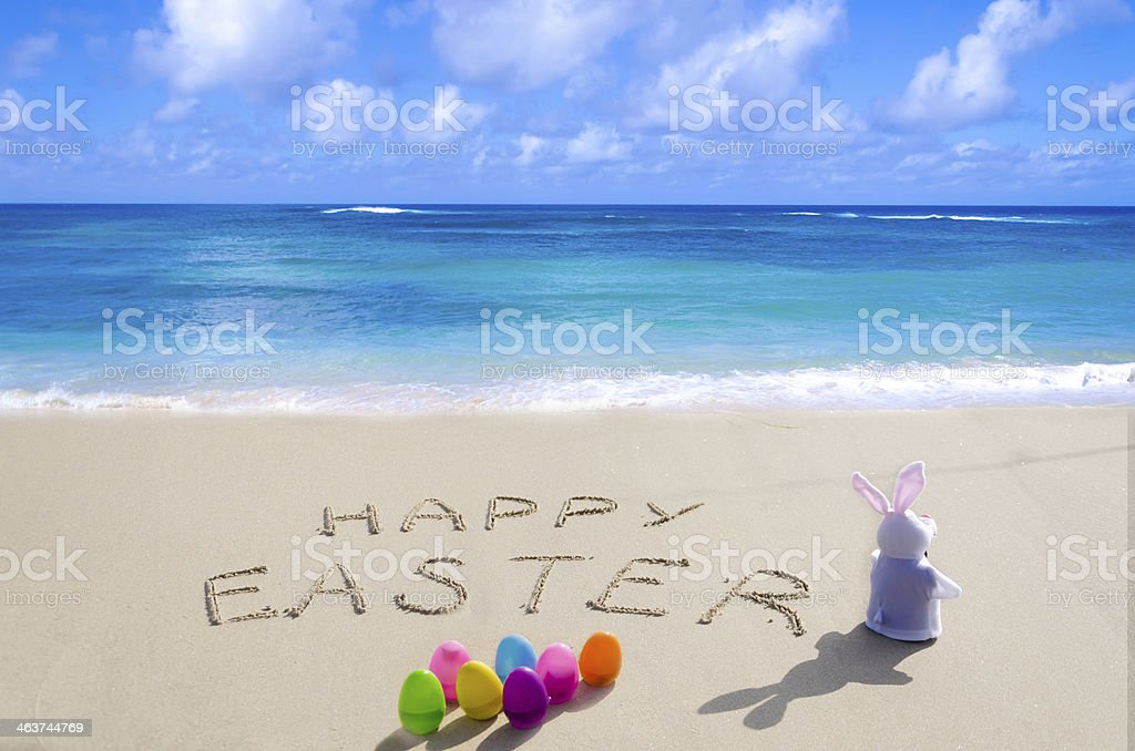 Sign Happy Easter with bunny on the beach royalty-free stock photo