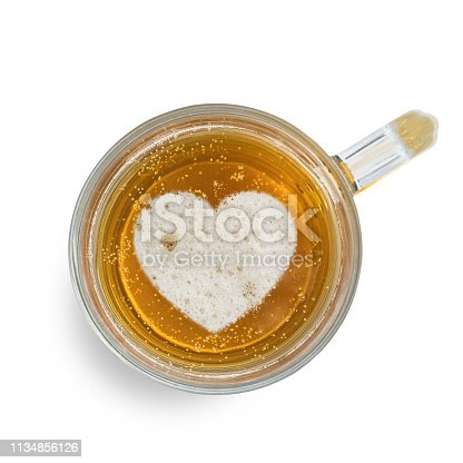 1144550840istockphoto Sign heart on the beer foam in glass isolated on white background. Top view 1134856126