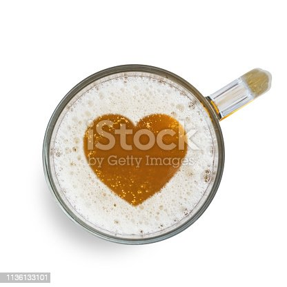 1144550840istockphoto Sign heart on the beer foam in glass isolated on white background. Top view 1136133101