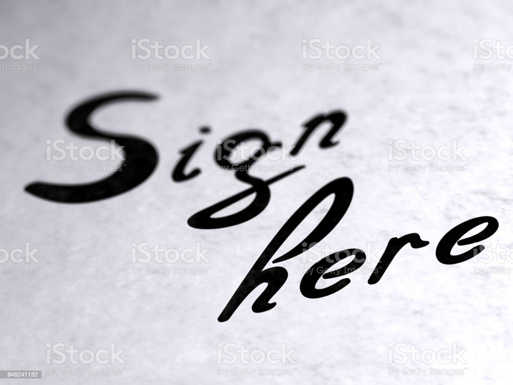 'Sign here' on the page. stock photo