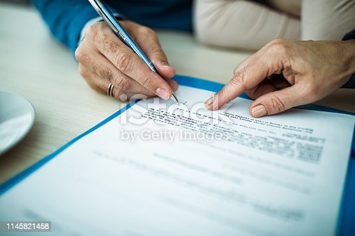 1072035844istockphoto Sign here please! 1145821458