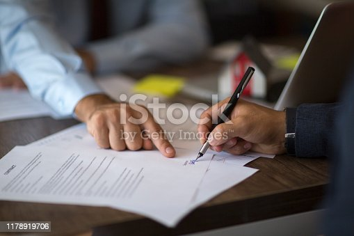 1072035844istockphoto Sign here please! 1178919706