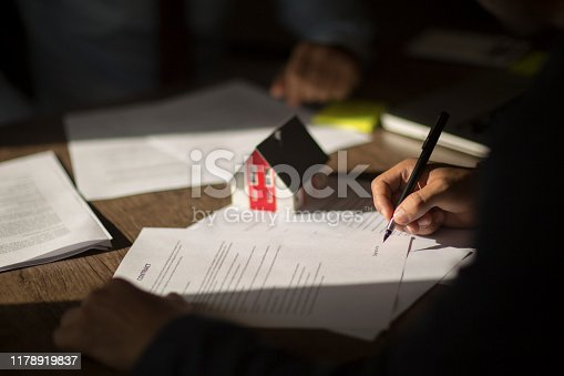 1072035844istockphoto Sign here please! 1178919837