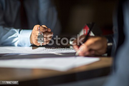 1072035844istockphoto Sign here please! 1178921037