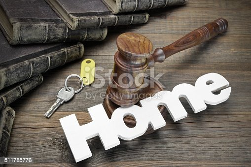 istock Sign Home, Key, Judges Gavel And Book On Wood Table 511785776