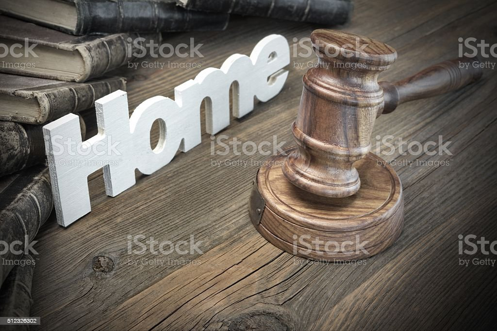 Sign Home,Judges Gavel And Old Book On Wood Table stock photo