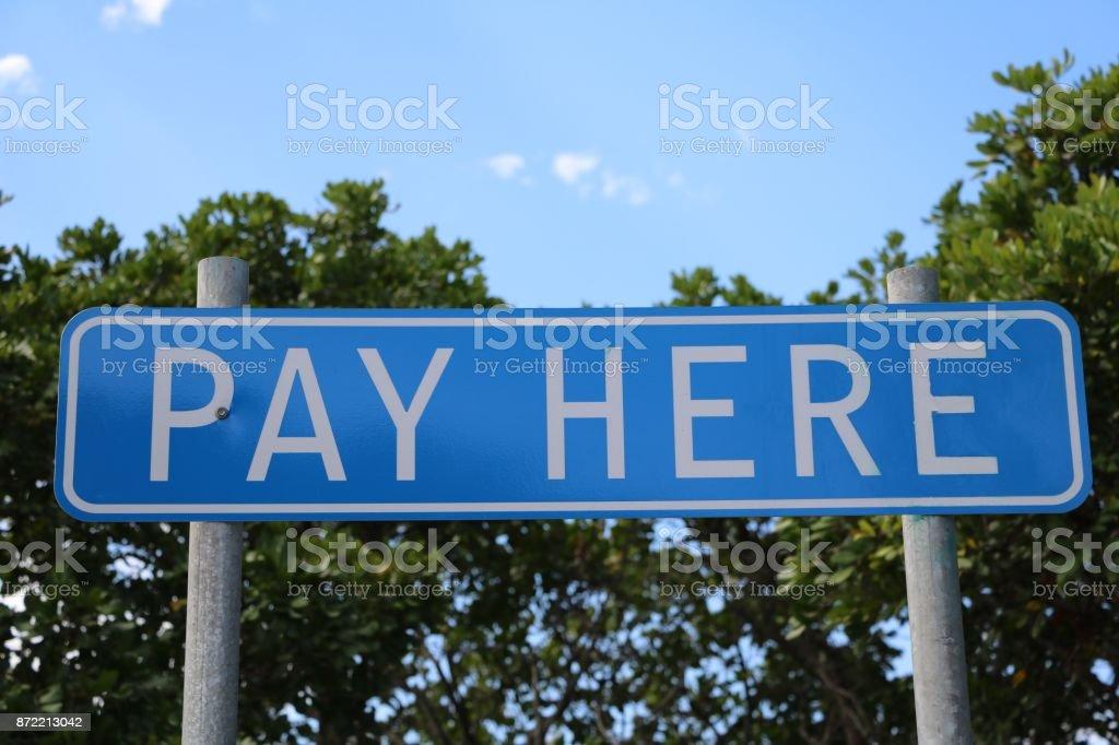 Sinal pagar aqui na Austrália - foto de acervo