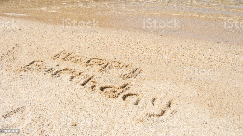 Sign In Beach Sand Saying Happy Birthday Royalty Free Stock Photo