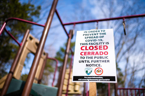 Sign in children's playground in Virginia city for park closure, facility closed to public due to covid-19 stock photo