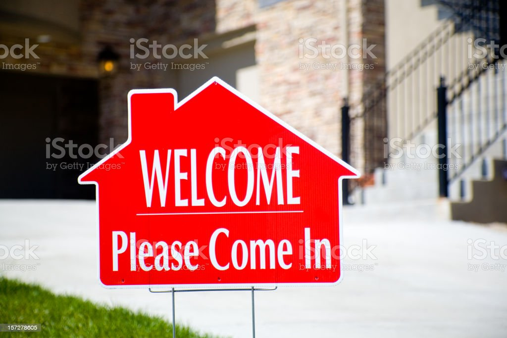 WELCOME sign in front of home royalty-free stock photo