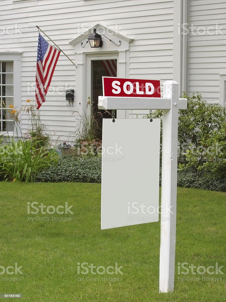 SOLD sign in front of mansion stock photo