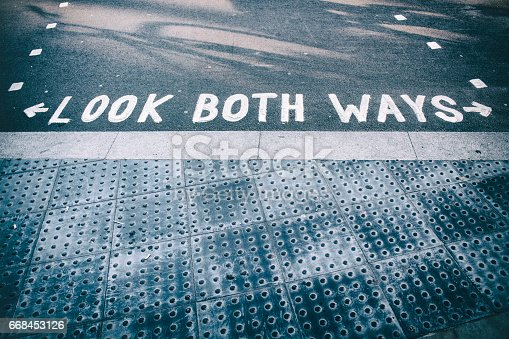 istock LOOK BOTH WAYS sign in London, UK 668453126