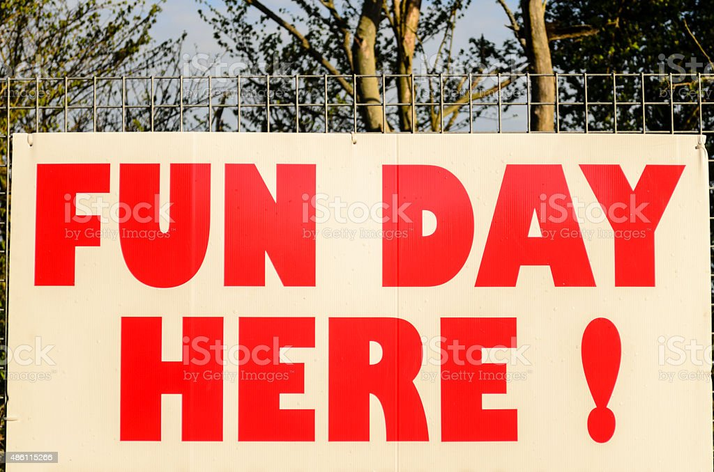 Sign in red, fun day here, stock photo