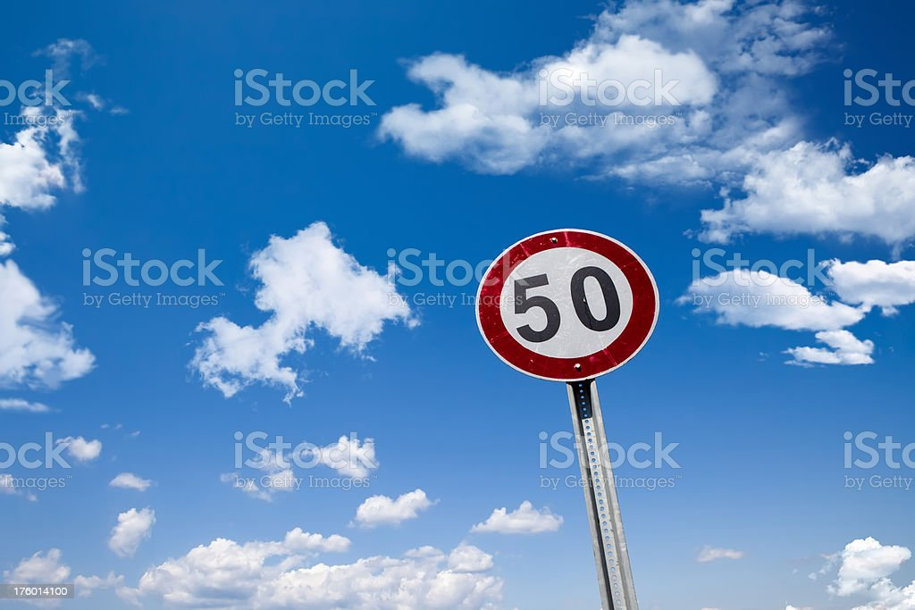 Sign in the blue cloudy sky royalty-free stock photo