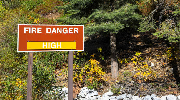 A sign in the Yosemite national park warns residents of the high wildfire danger in summer stock photo