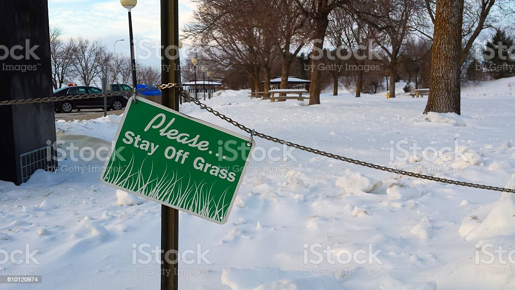 Sign in Winter Saying, 'Please Keep Off the Grass' stock photo