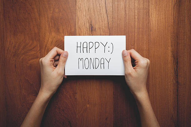 sign in woman's hands with the words happy monday - monday motivation stock photos and pictures