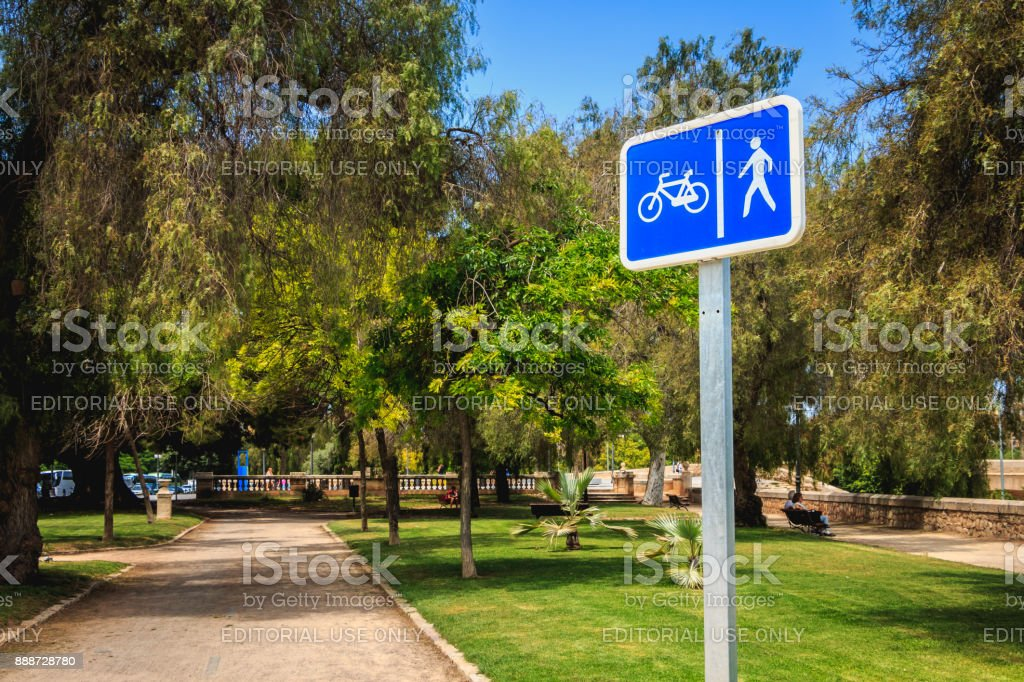 sign indicates a path for bicycles and pedestrians stock photo