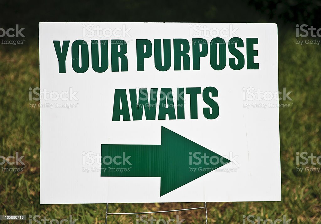 A sign indicating in green that your purpose awaits this way royalty-free stock photo