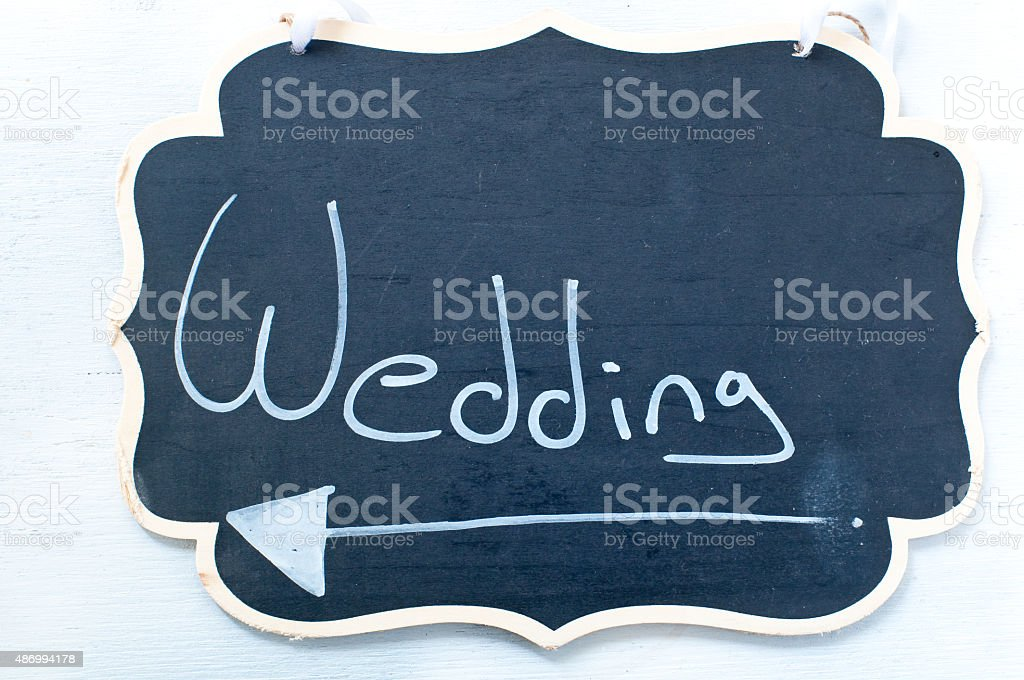 Sign indicating the marriage during a ceremony stock photo