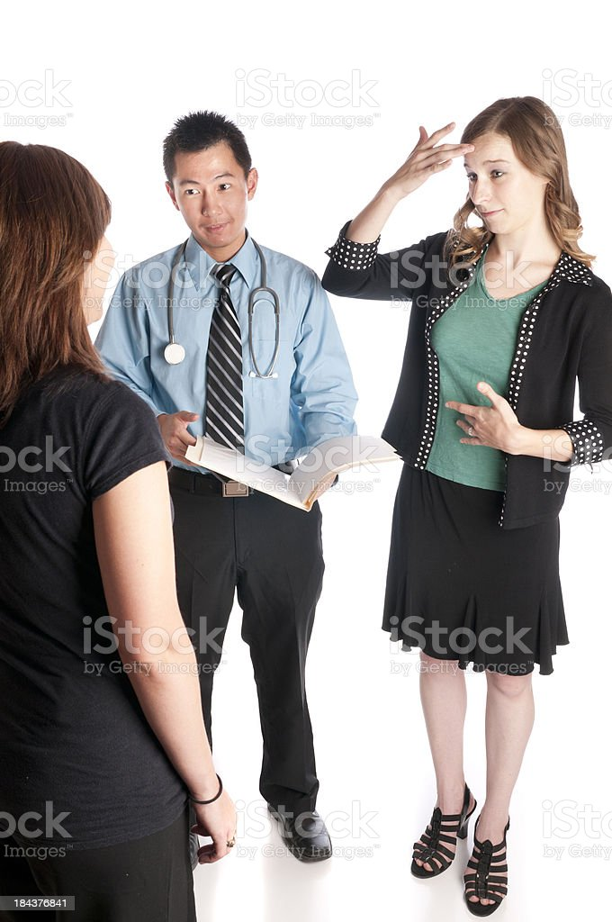 Sign Language Interpreter and Patient with Asian Doctor stock photo
