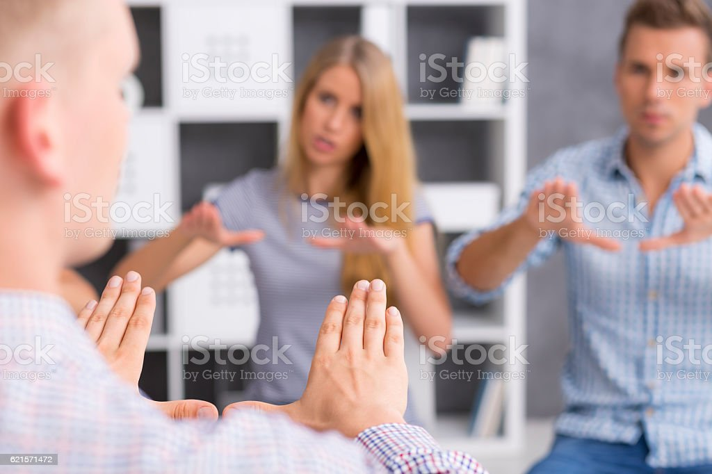 Sign language learners repeating new sign after their teacher stock photo