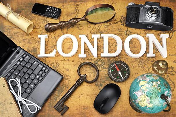 sign london, laptop, key, globe, compass, phone, camera, letter, - sprüche über reisen stock-fotos und bilder