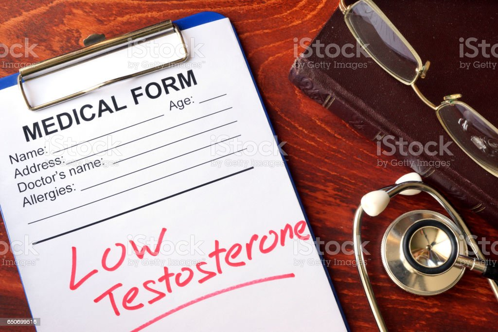 Sign low testosterone in a medical form. stock photo