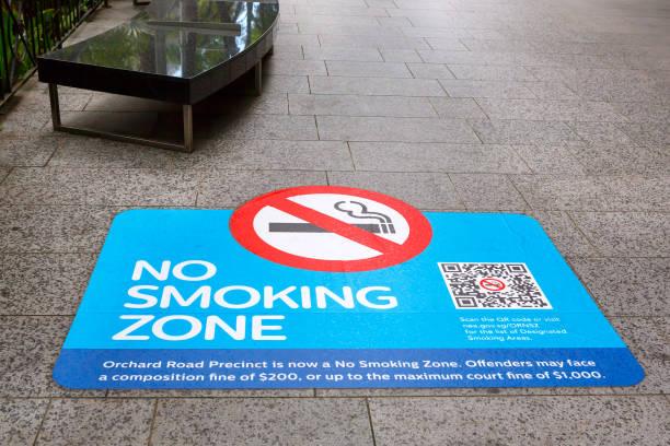 Sign no smoking zone on the sidewalk Orchard Road, Singapore. stock photo