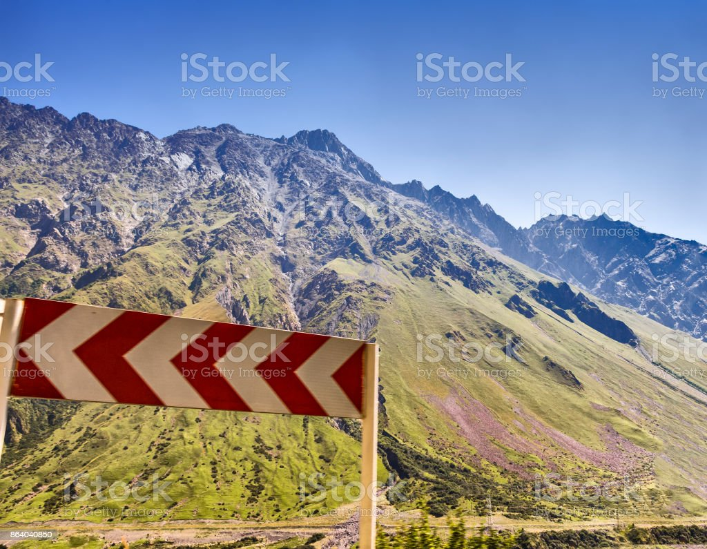 Sign of a sharp turn stock photo