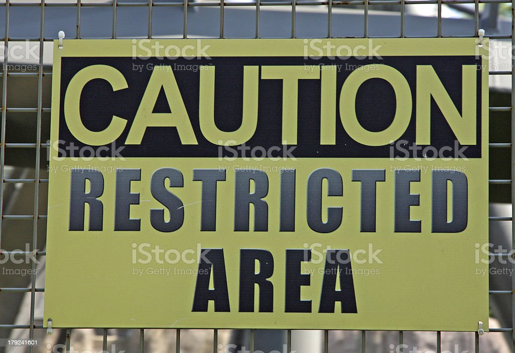 sign of attention to avoid crossing forbidden military zone royalty-free stock photo