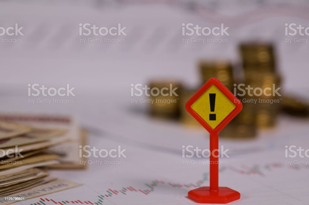 Sign of exclamatory mark on a stock market diagram. Sign of exclamatory mark on a stock market diagram. Closeup Business Stock Photo