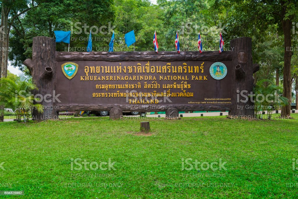 Kanchanaburi, Thailand - Nov 7, 2015: Sign of Khuean Srinagarindra National Park  in Thai and English.The park centred on the Srinagarind Reservoir is part of the Western Forest Complex protected area stock photo