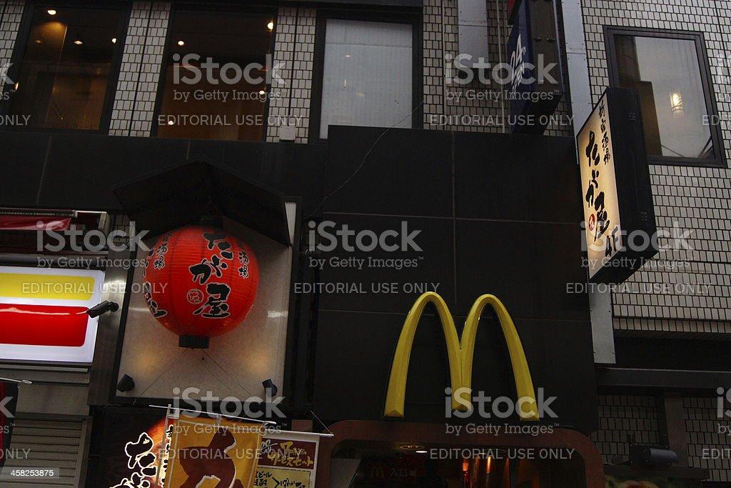 Sign of Mc Donalds next to traditional Japanese lantern royalty-free stock photo